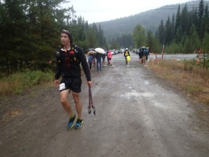 Runner coming into Bonnevier aid station in miserable weather.